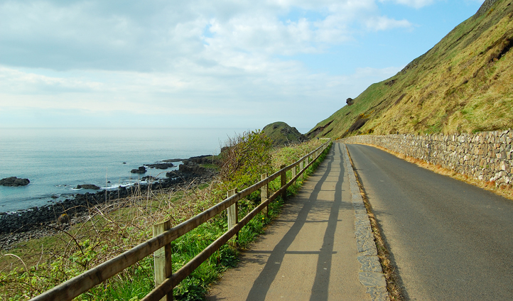 Drive the County Antrim coastal road and feel the bracing sea breeze