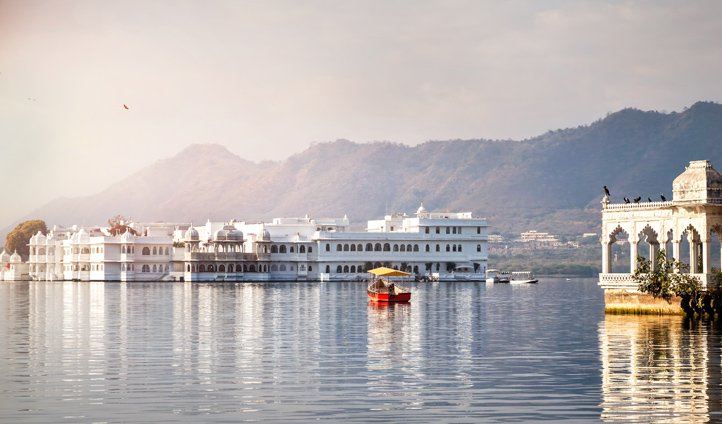 Take a boat out to your hotel at Taj Lake Palace