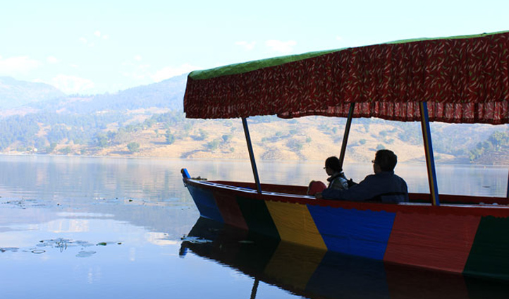 Explore Begnas Lake onboard a traditional Shikara boat