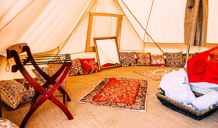 Traditional furnishings adorn your tent