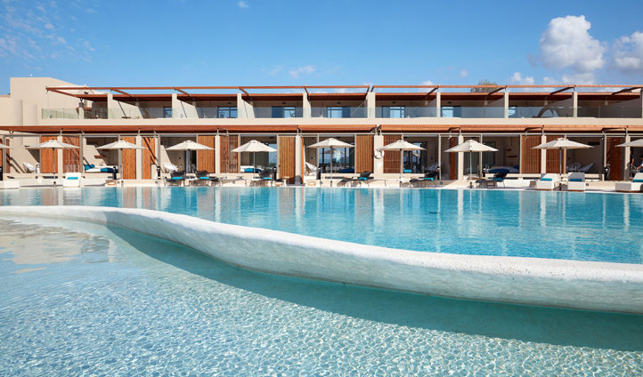 Relax by the pool at Domes Noruz Chania