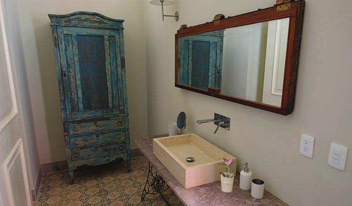 Antique bathroom decor in the Malecon Suite