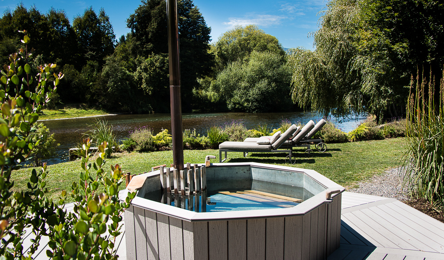 Relax in the hot tub overlooking the river