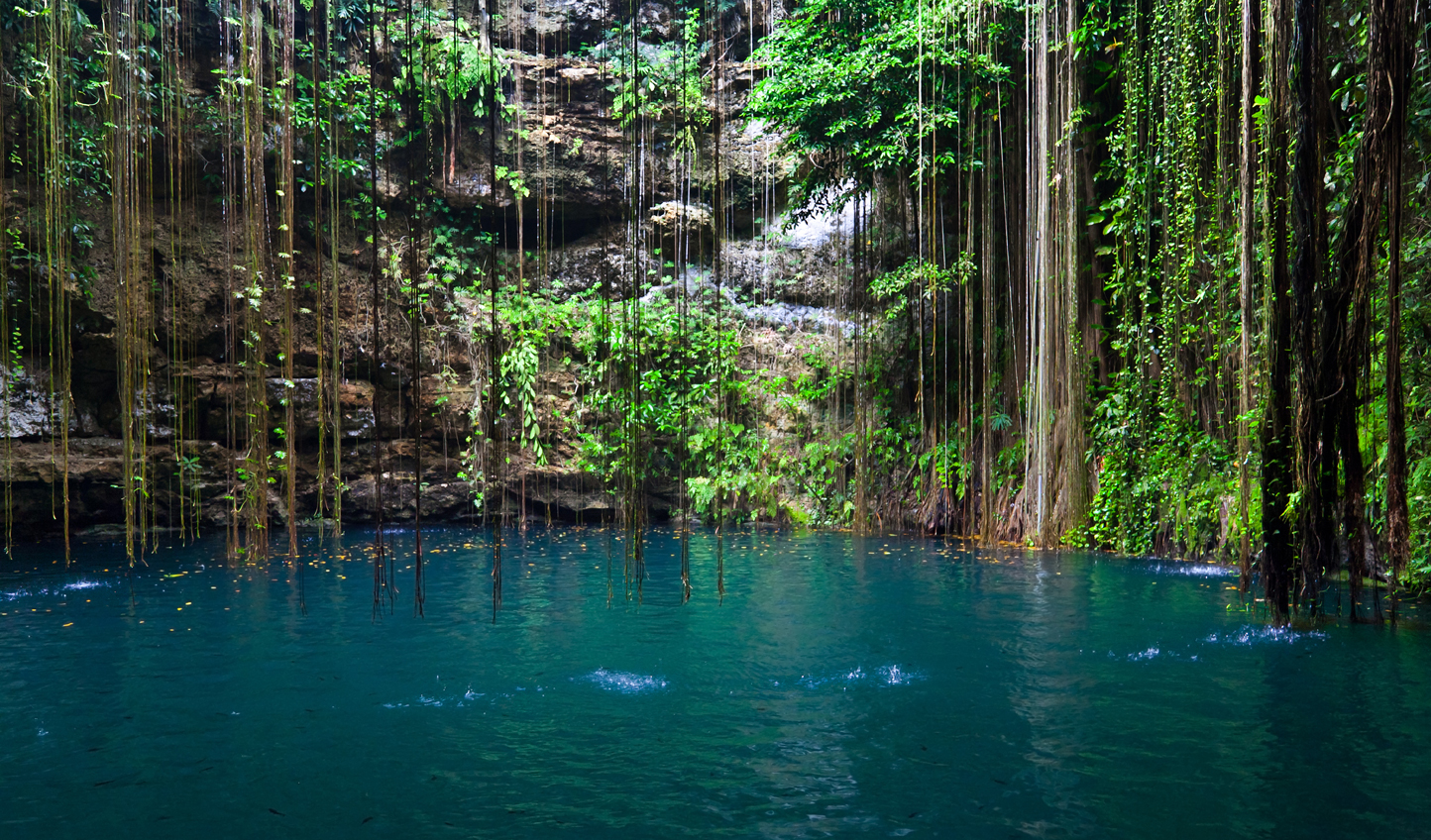 Take a dip in the azure waters of Cenote Ik-Kil