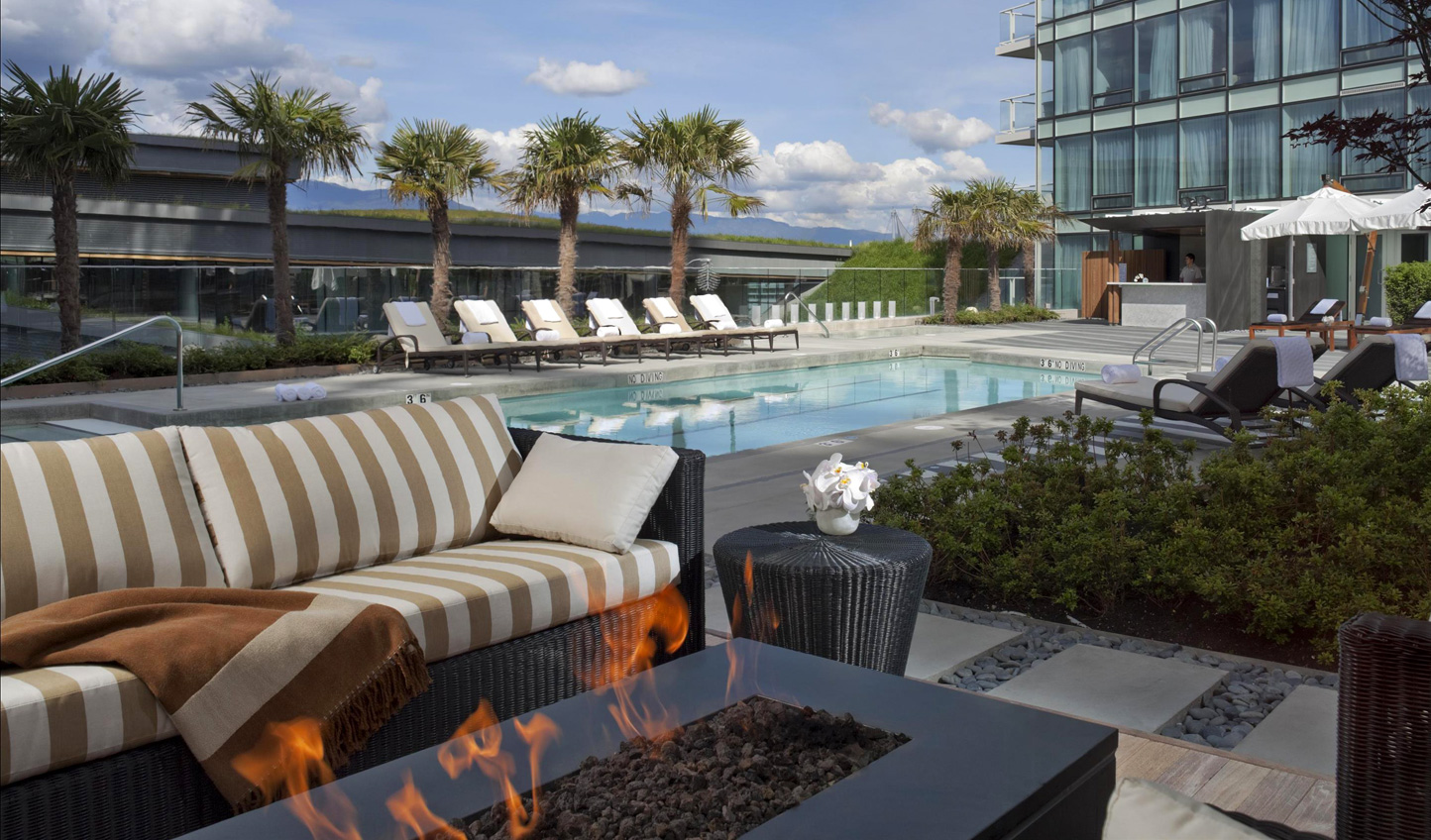 Relax by the pool with a warm fire crackling nearby
