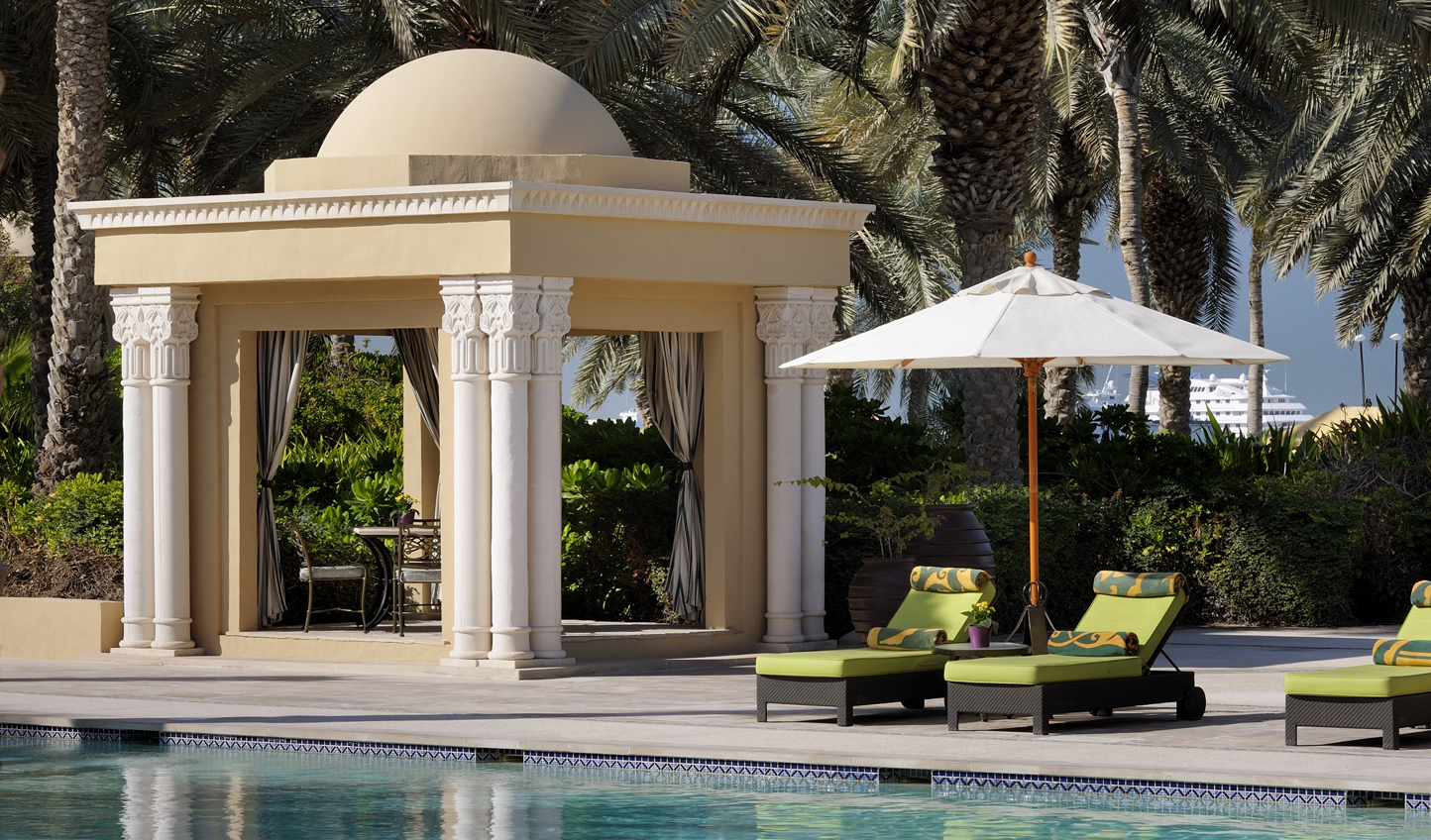 Spend your days lounging by the pool in the shade of the swaying palm trees