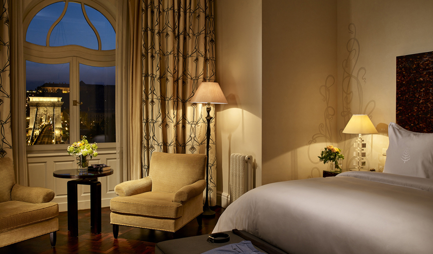 Admire the city lights from the comfort of your suite