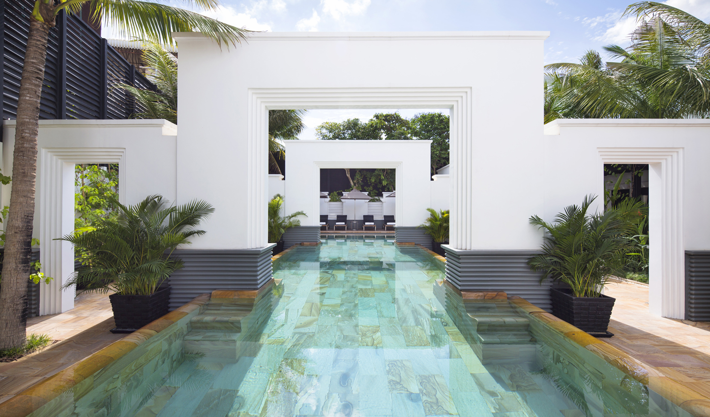 Cool off from the tropical heat in the reinvigorating waters of the saltwater pool