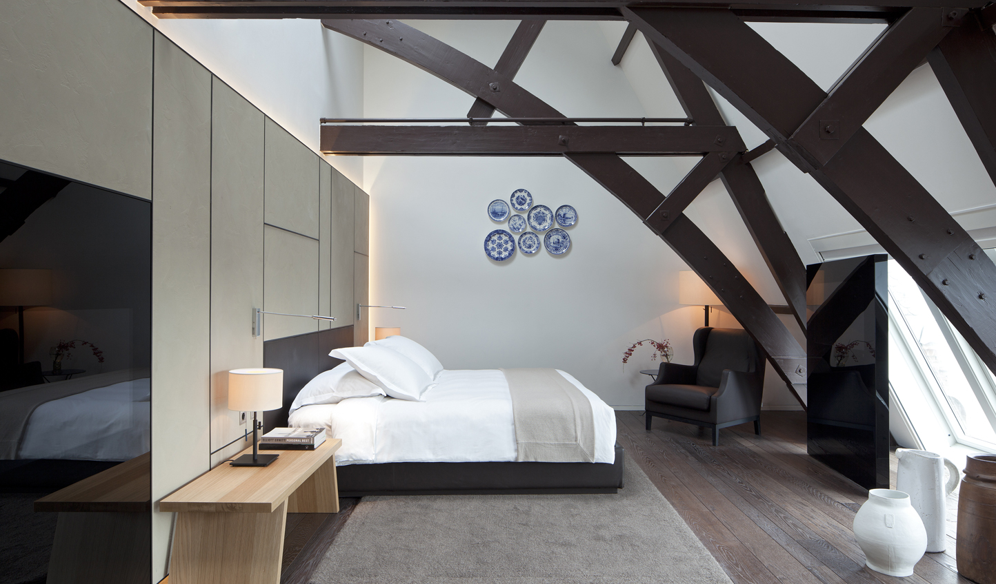 Sleep up in the eaves at Conservatorium Hotel