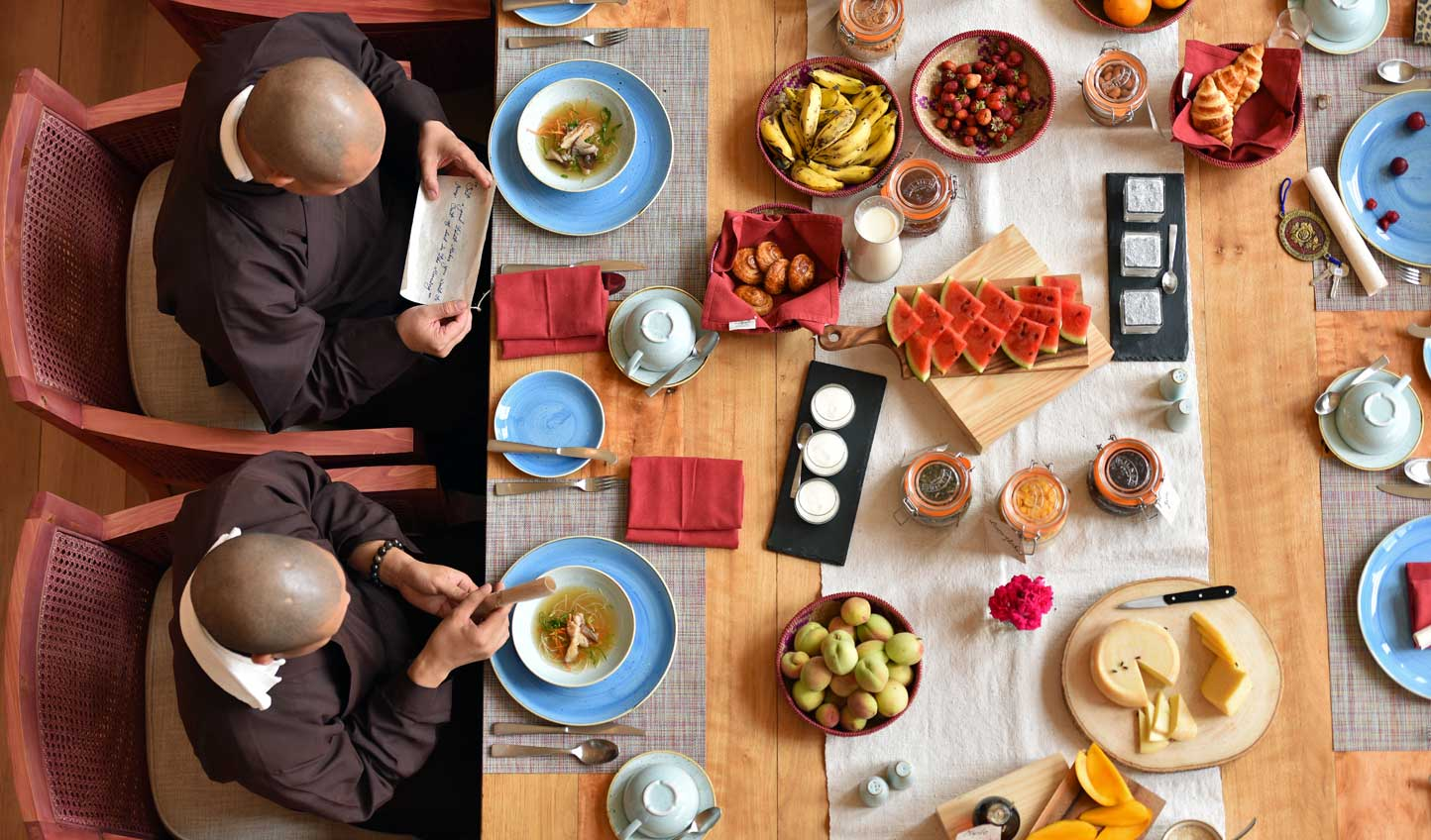 Join the monks for a hearty breakfast of traditional delicacies