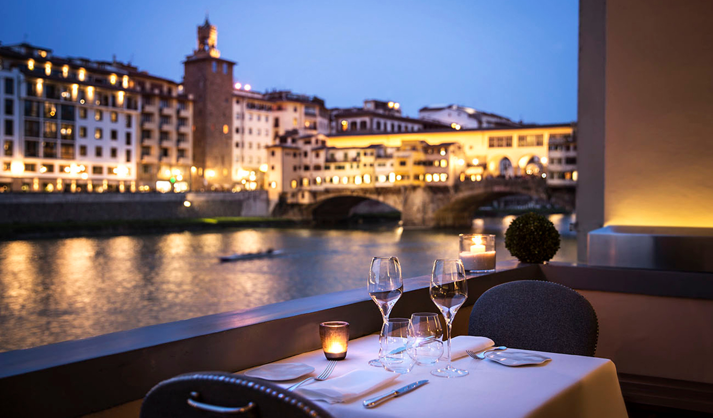 Dine on the banks of the Arno River