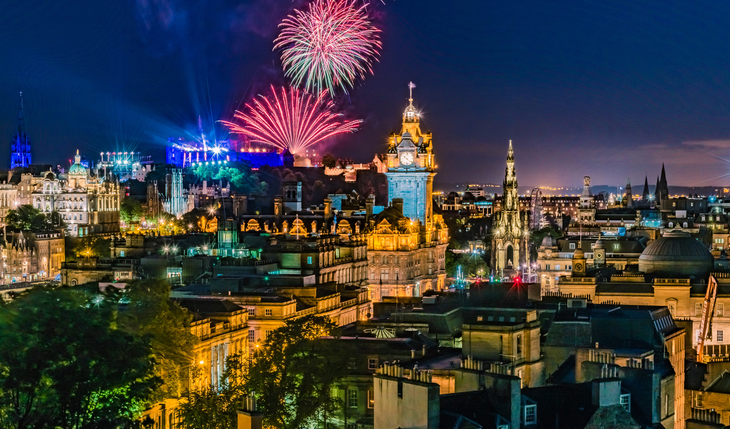 Visit Edinburgh in August and watch the fireworks of the Royal Military Tattoo light up the sky