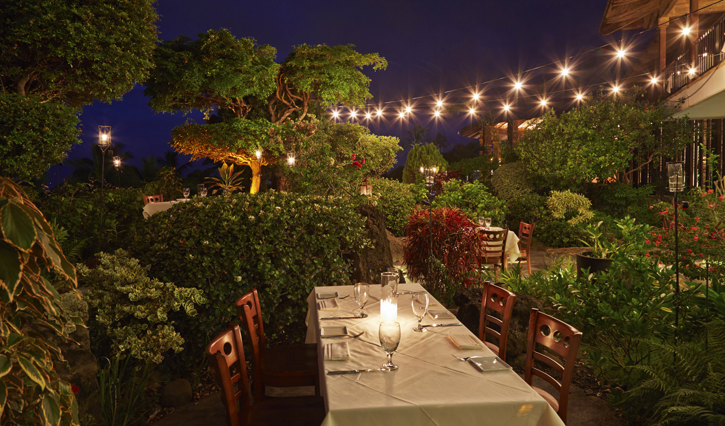 Dine out in the garden and feel the ocean breeze on the air