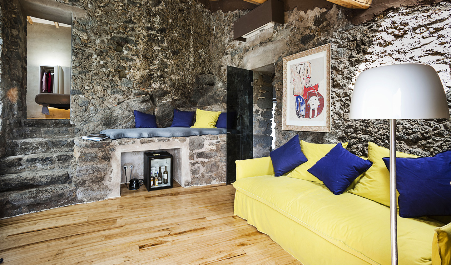 Lava-stone rooms come with splashes of colour.