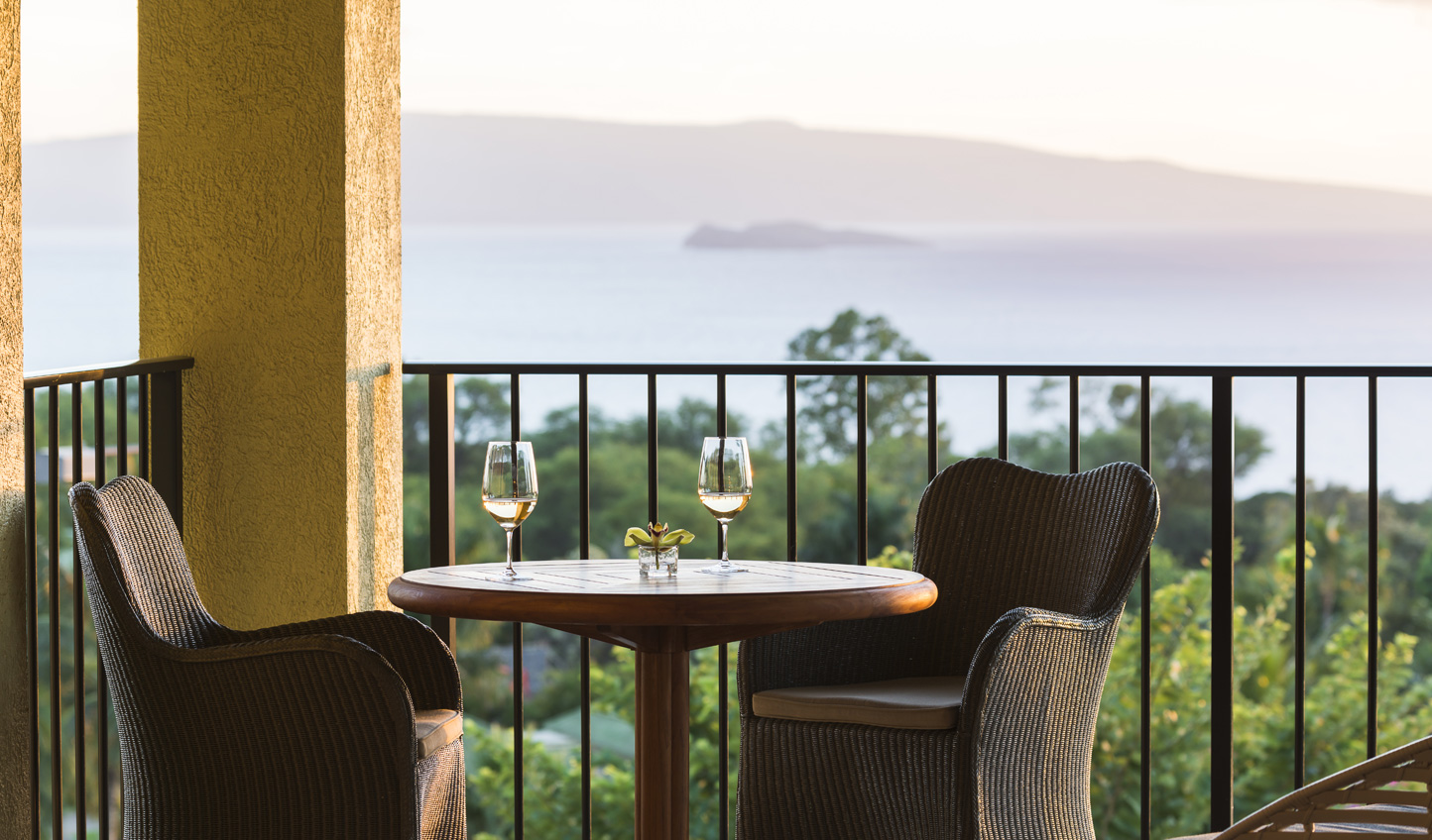 Enjoy a glass of wine over fiery sunsets on your private balcony