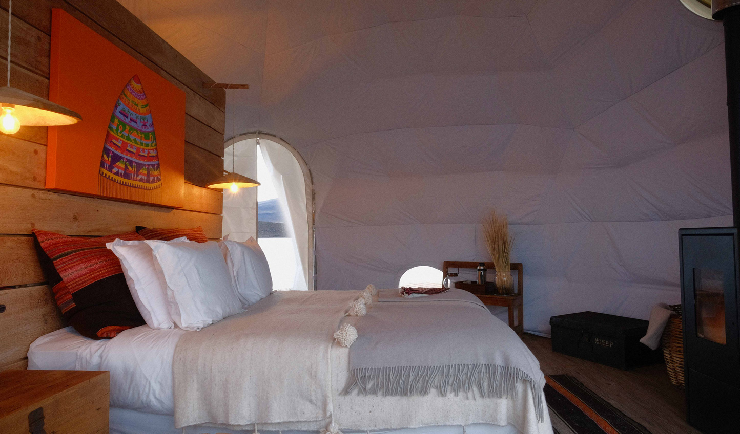 After a day exploring the Salar, return to your beautiful tented room