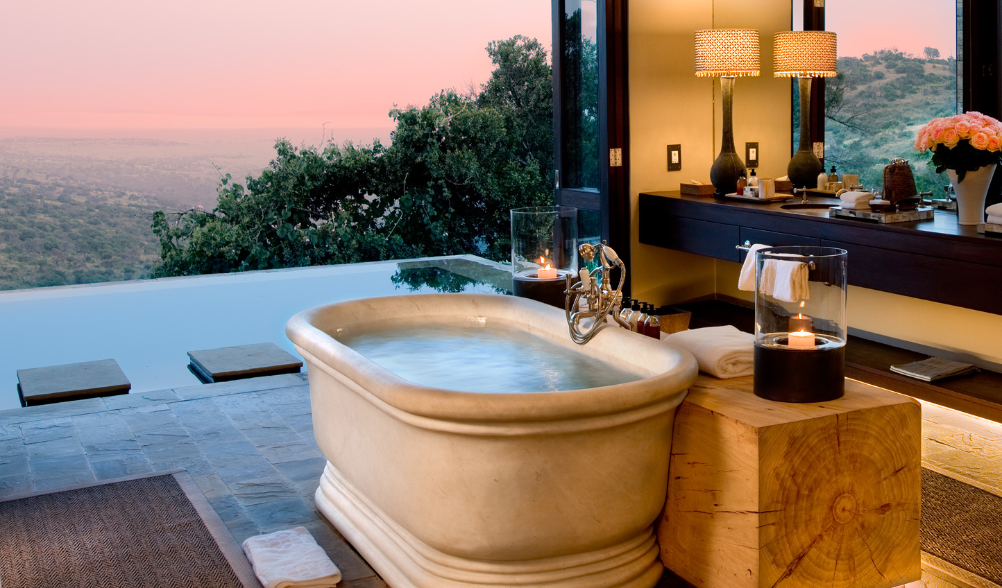Lie back in the marble tub of the Master Suite and watch animals grazing in the valley below