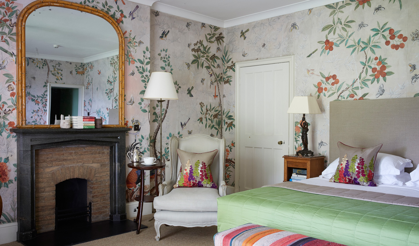 Handpainted wallpapers complement stunning fabrics