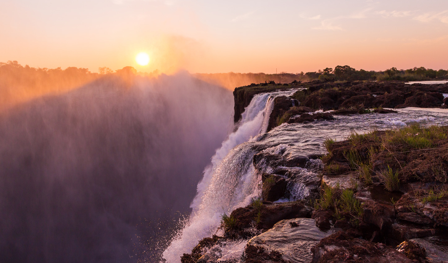 Peek over the edge of Victoria Falls from Devil's Pool