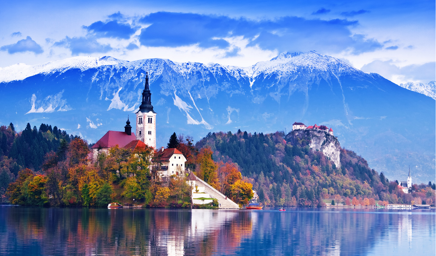 Sail across Lake Bled and sample their famous cream cakes