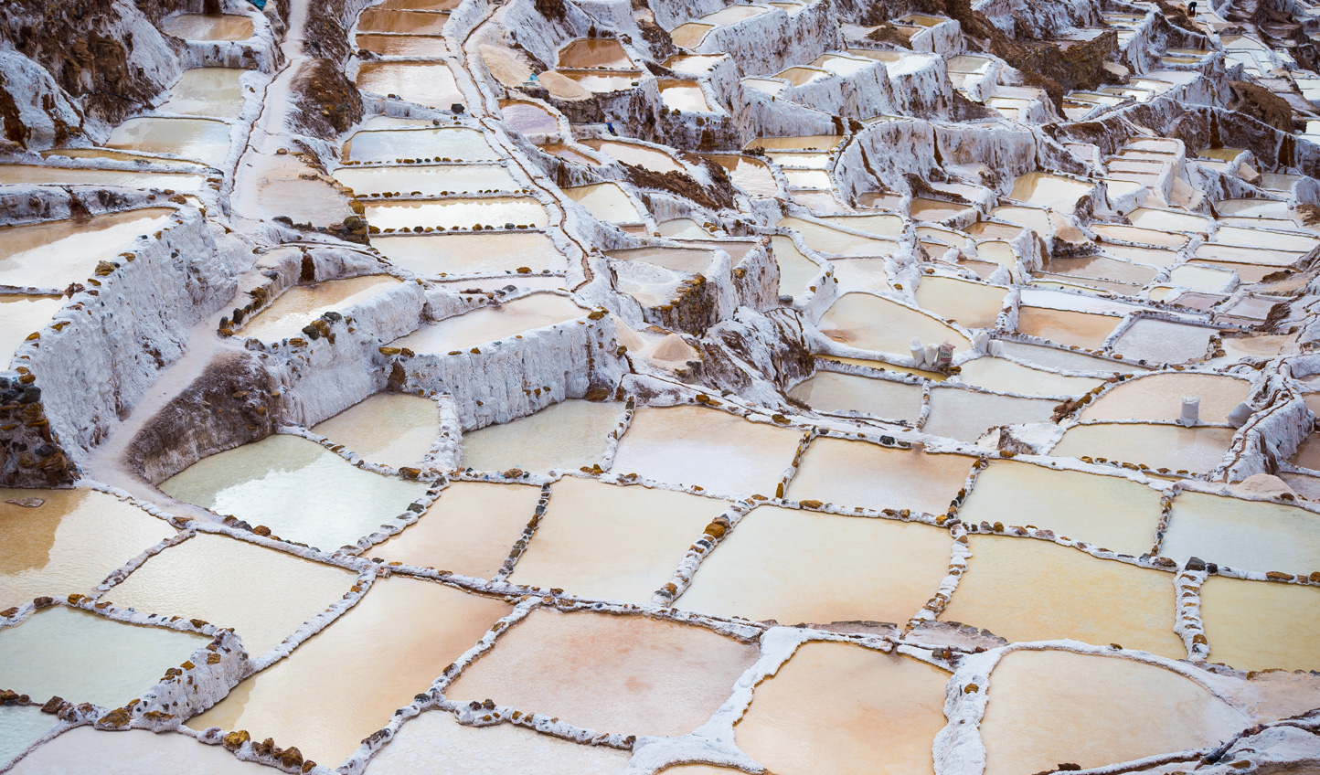 Stop by Maras and marvel at the luminescent hues of the salt mines