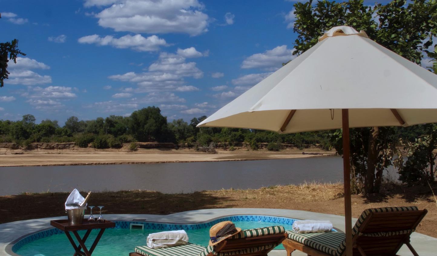 Sunbathe by the pool under the hot Zambian sun