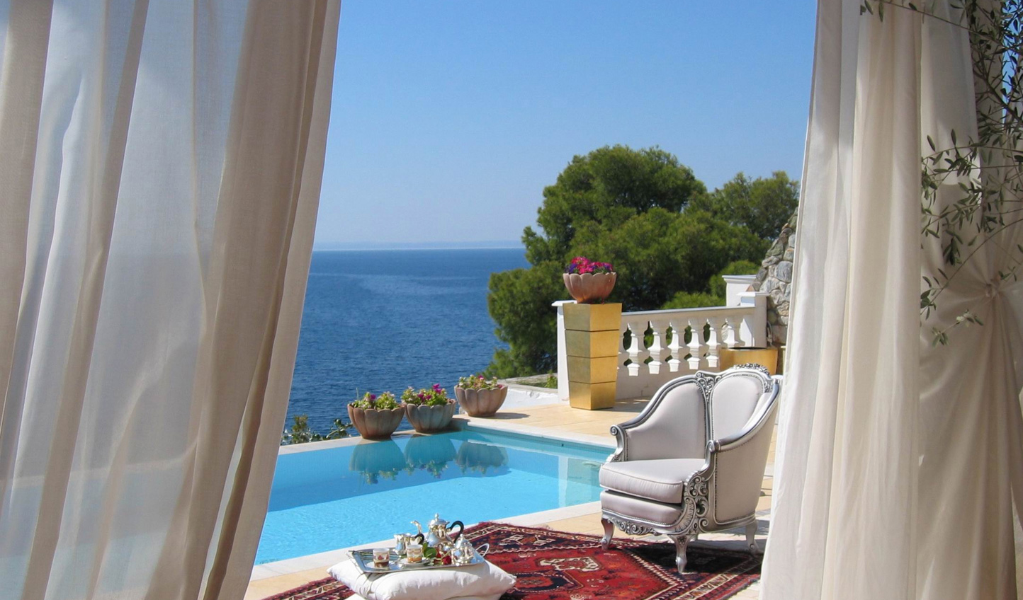 Dive on in to your private pool overlooking the sea below