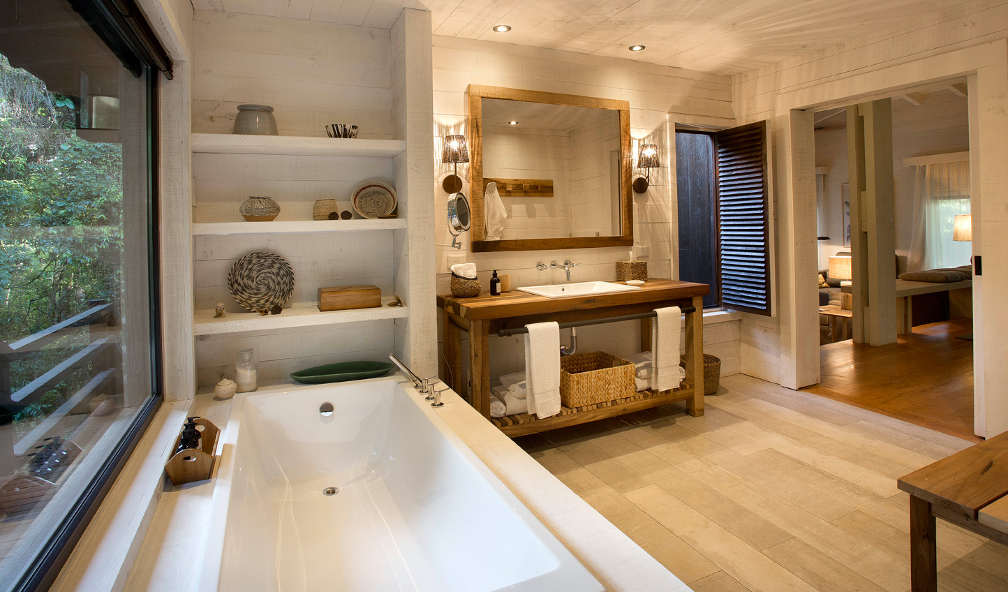 Soak in the sights of the jungle from your luxurious villa bathroom