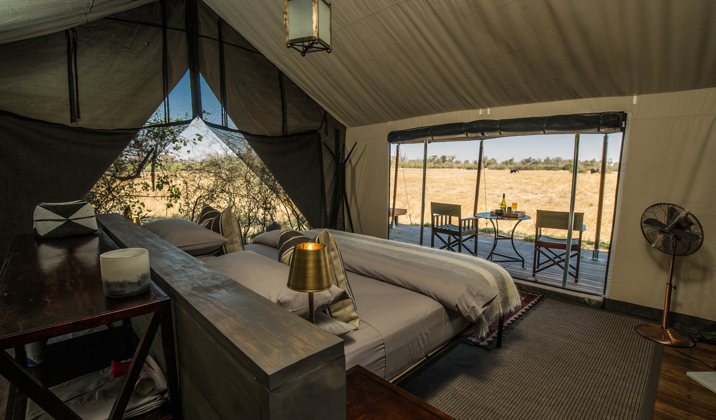 Stay at Machaba Camp and see animals wander past your tent