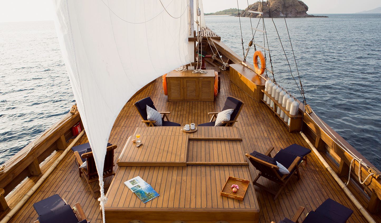 Pristine 75 feet wooden yacht with graceful lines reminiscent of a traditional Phinisi schooner.