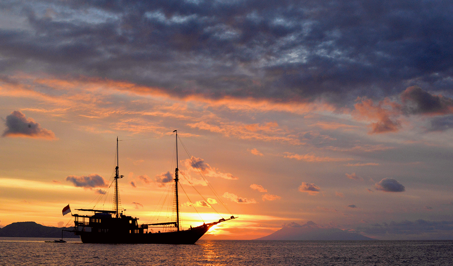 One last sunset before sailing back to Sorong's harbour