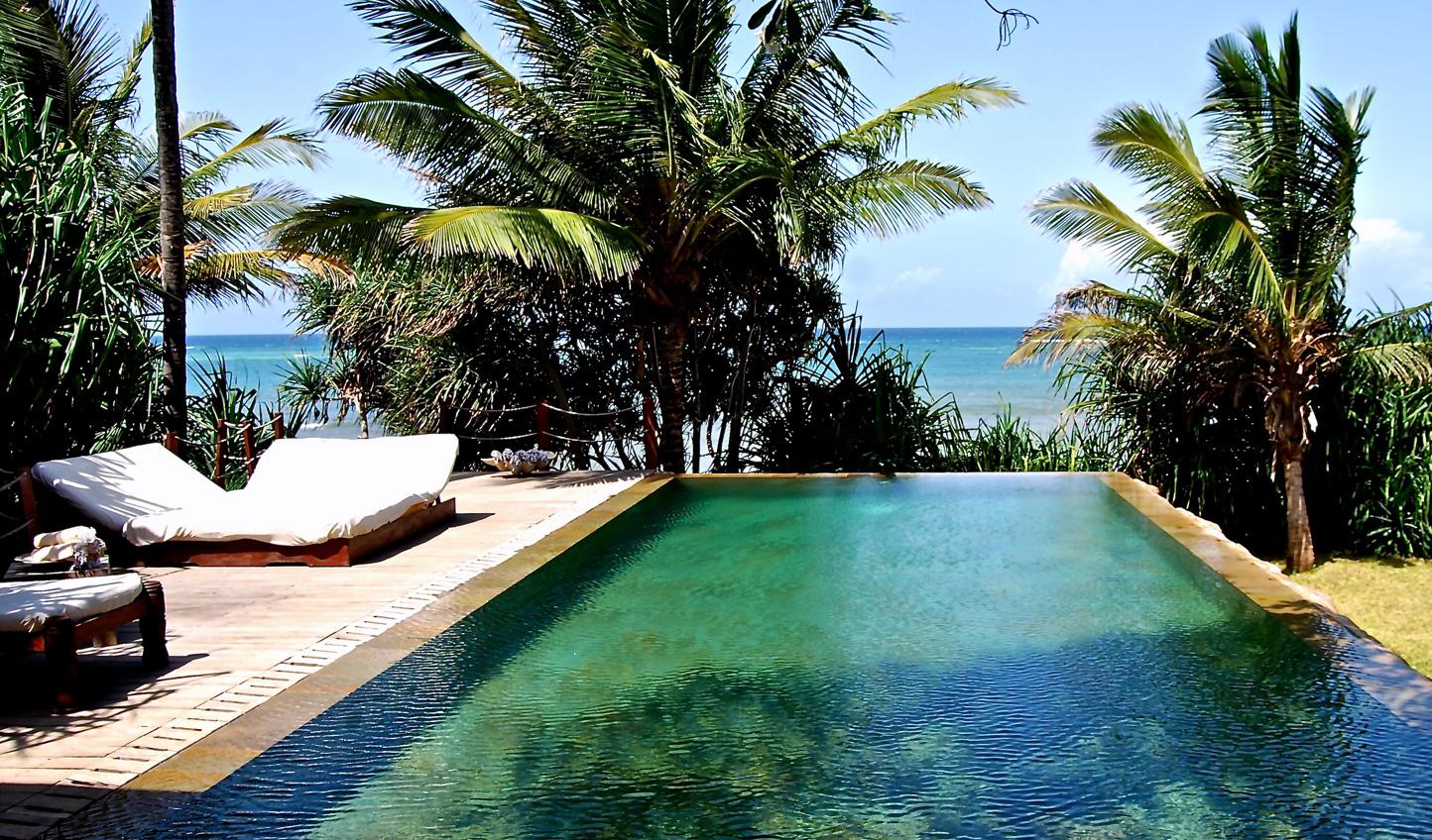 Shades of azure surround the Beach Villa