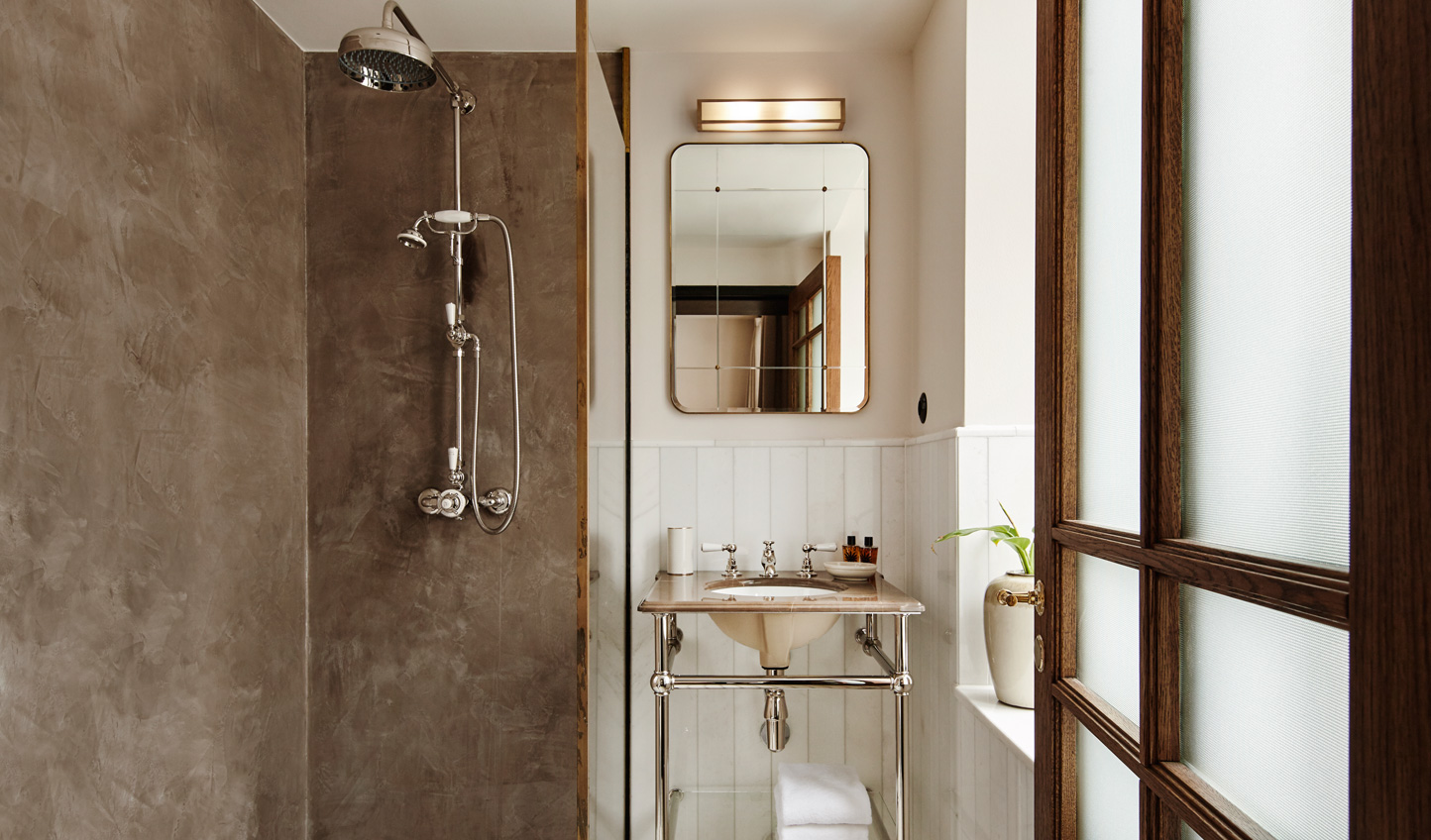 Boutique bathrooms crafted to reflect the design of Hotel Sanders