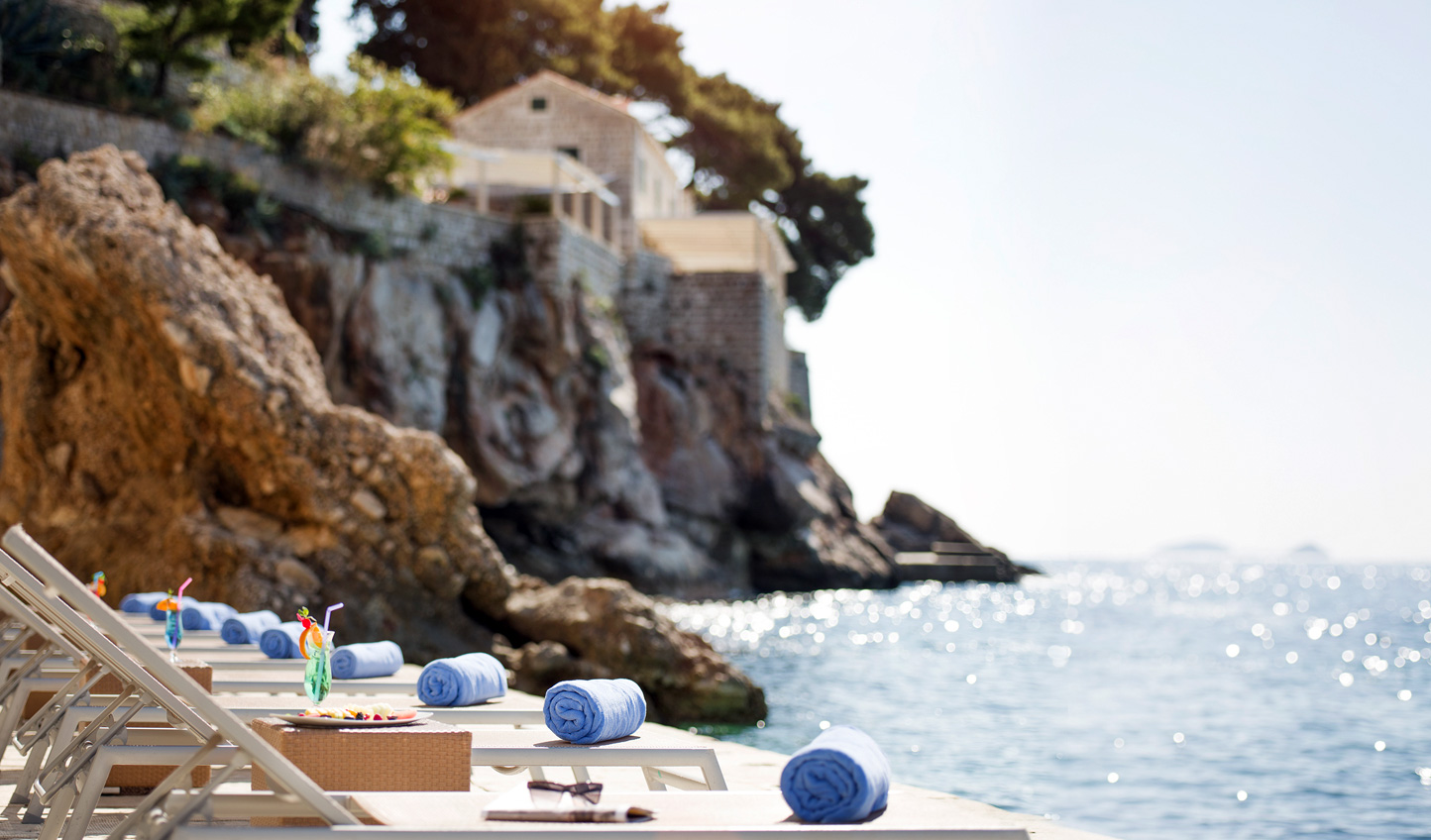 Dive into turquoise waters from the private beach at Hotel Excelsior