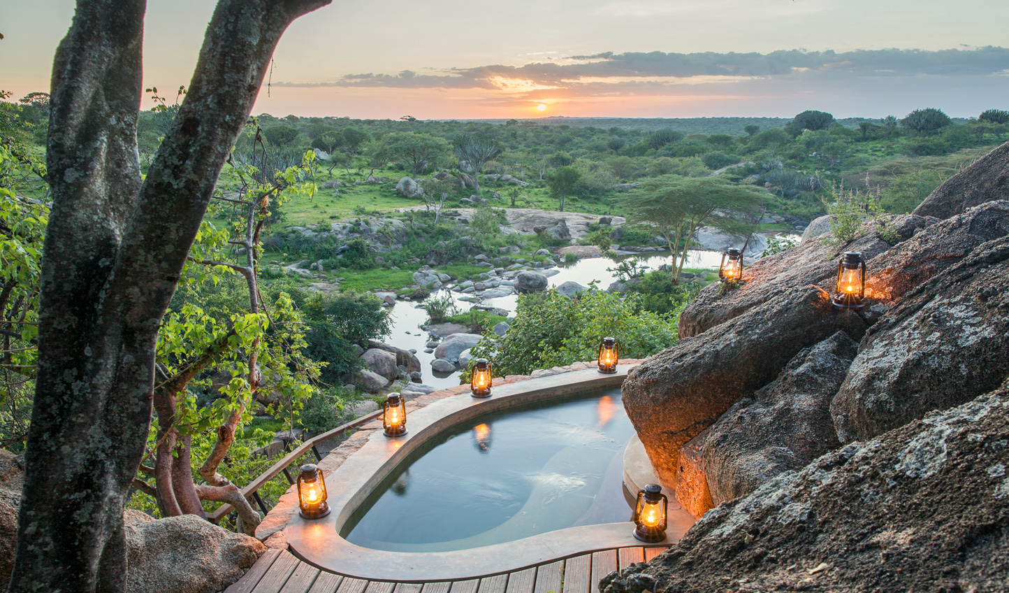 Take a romantic dip as the sun sets in the distance