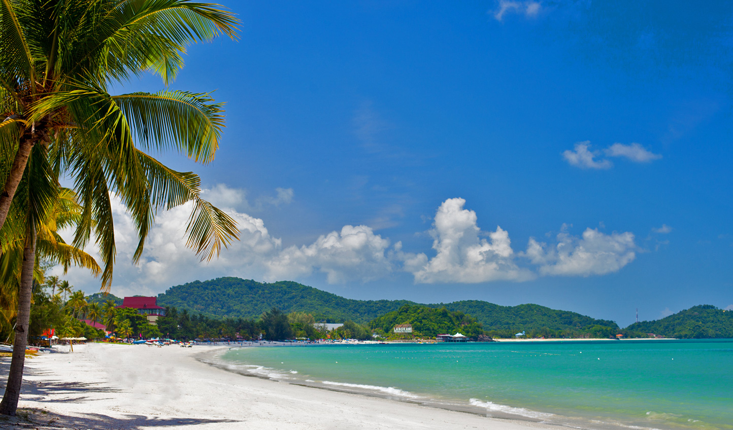 Gentle azure waves lap onto the fine sand beaches of Langkawi