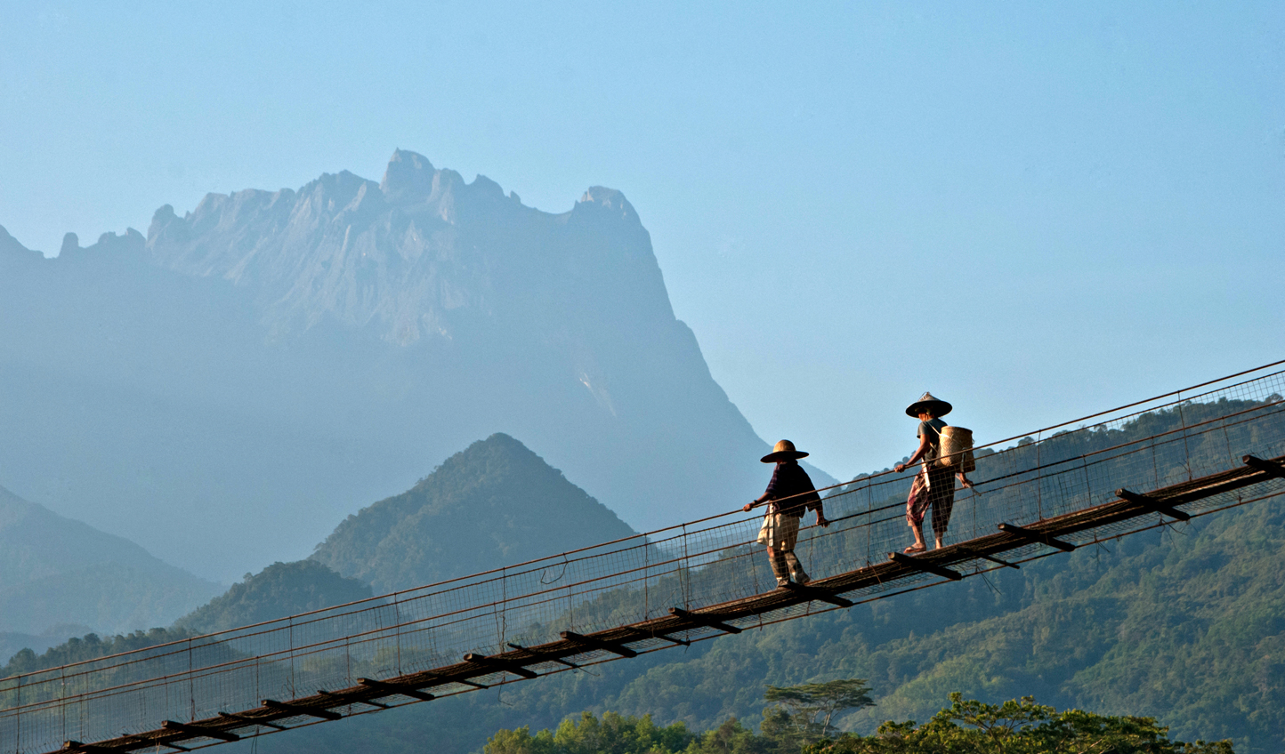Reward yourself with white-sand beaches after hiking to the top of Mount Kinabalu