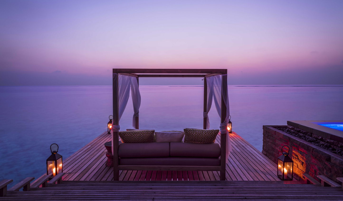 Watch the sun slip away from the comfort of your private cabana