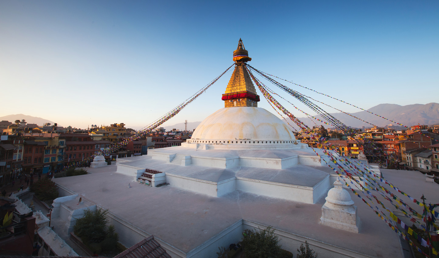 Stand shoulder to shoulder with Hundu and Buddhist pilgrims at the Holy Stupa of Boudhanath