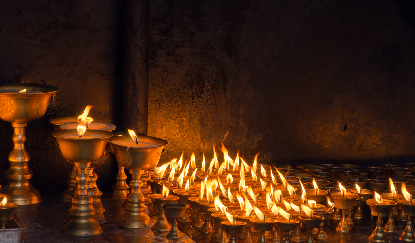 Step into temples lit only by candlelight
