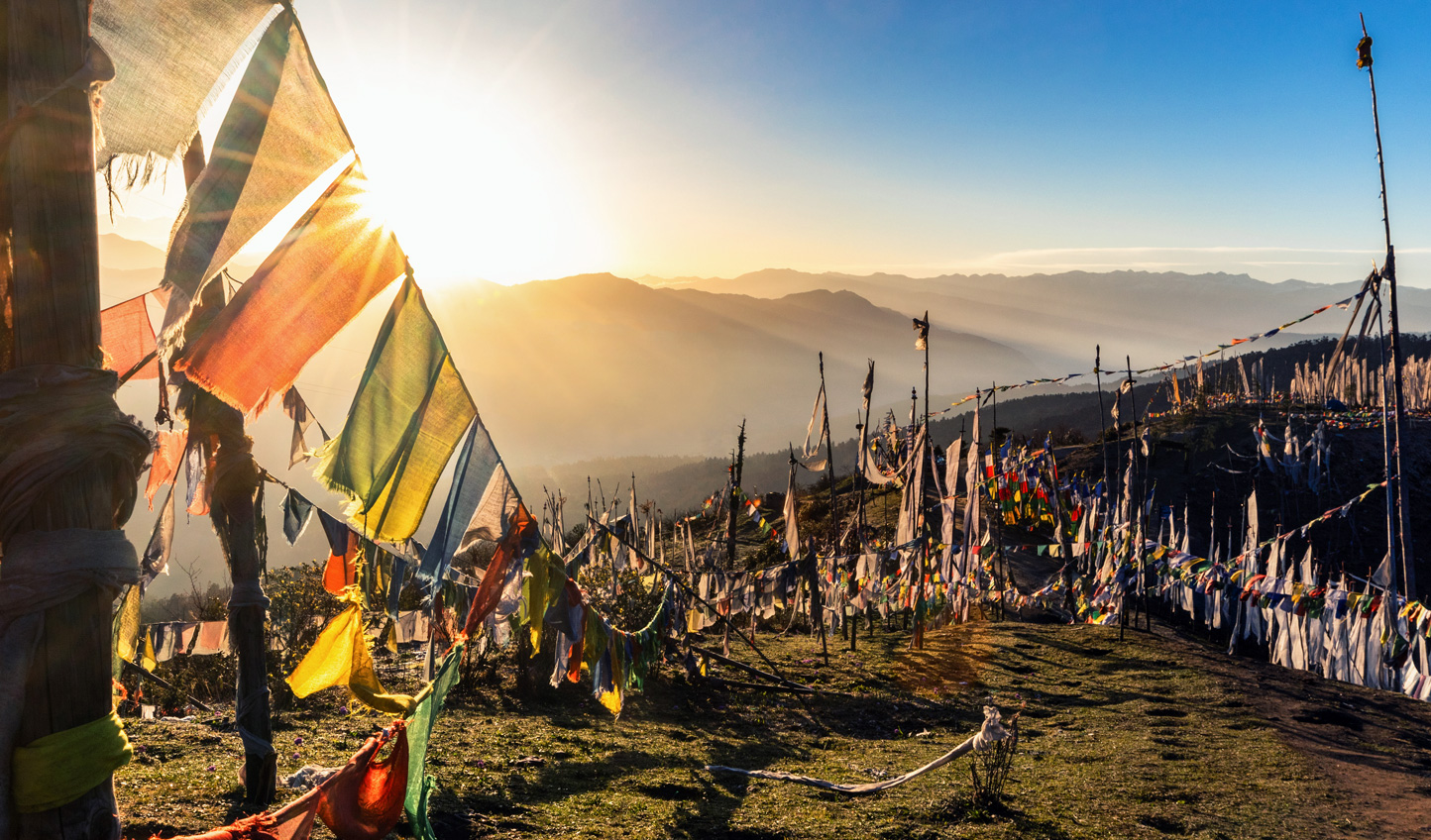 Head up to Chele La Pass and tie a prayer flag in the wind