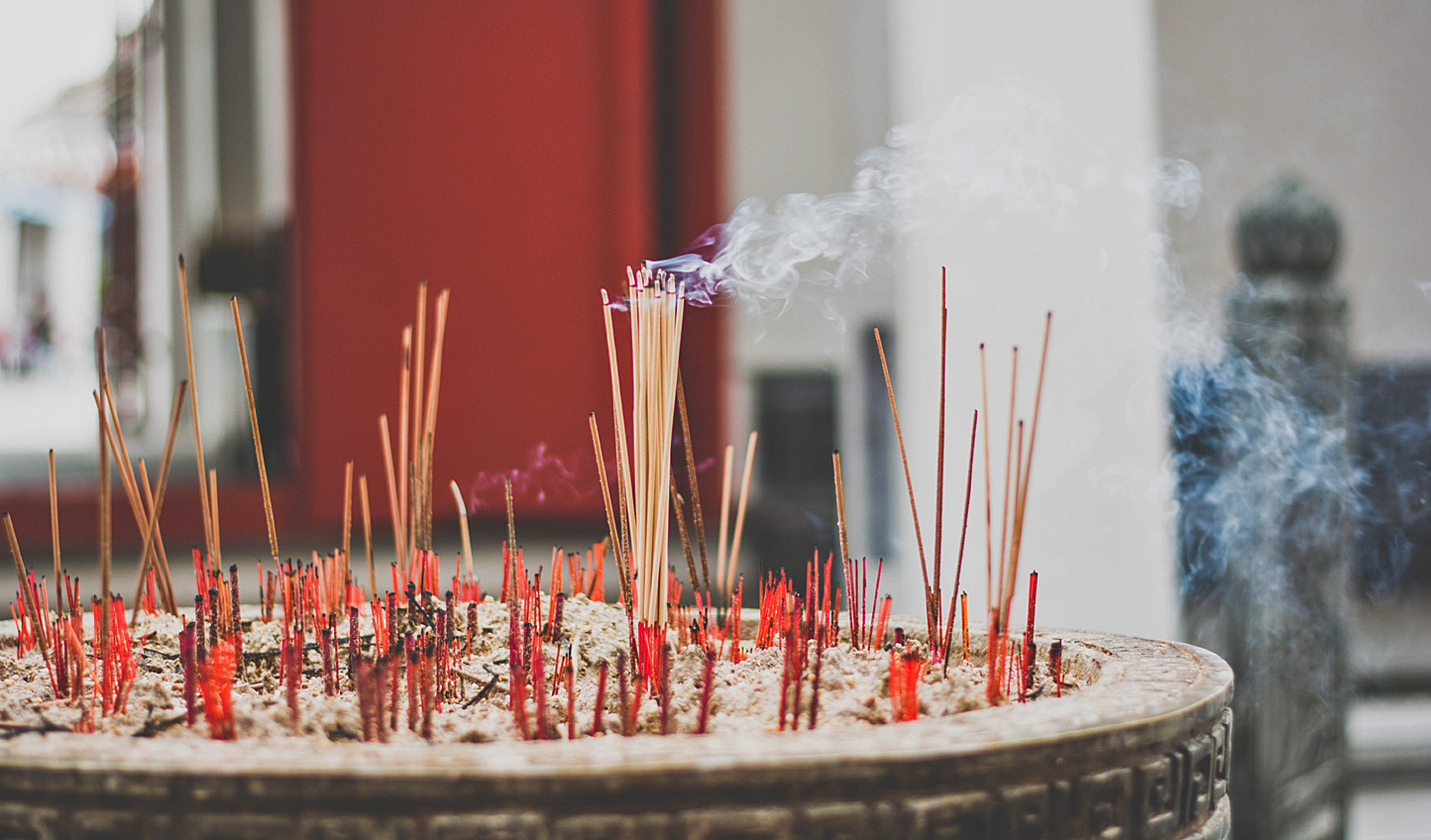 Breathe in the wafts of incense as you pass by temples