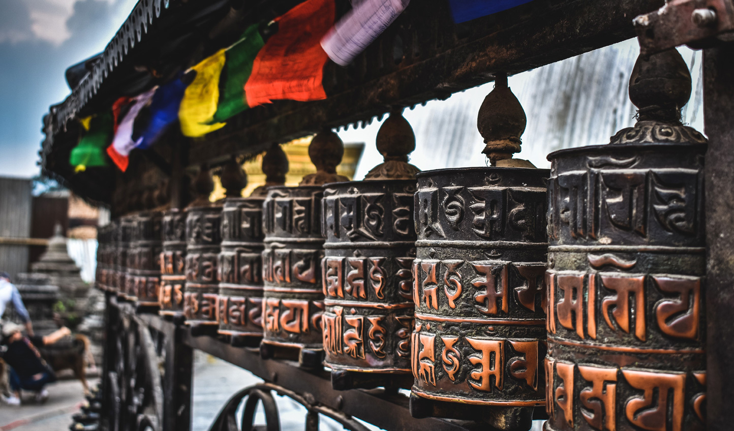 Spin the prayer wheels of Boudhanath