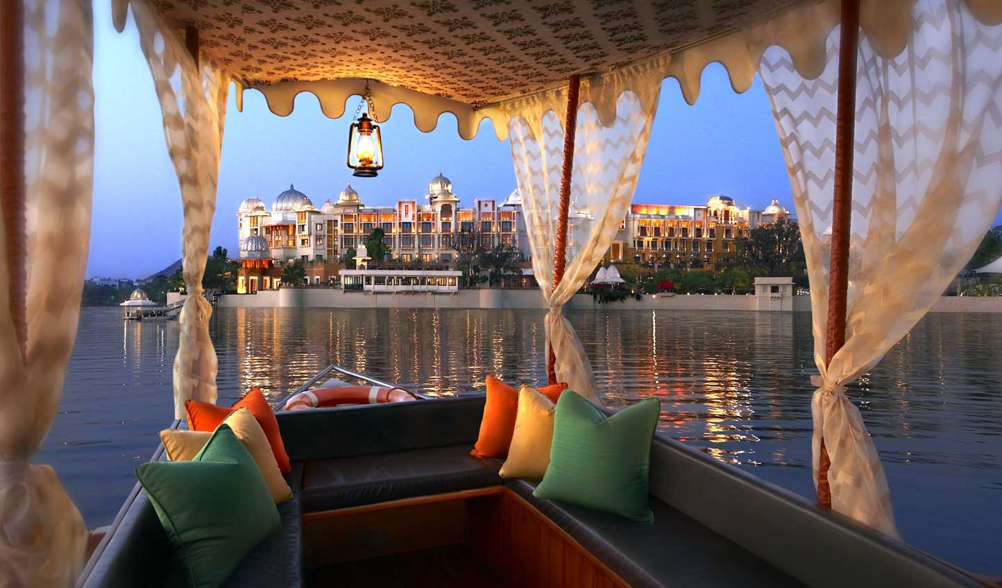 Arrive in style across the tranquil waters of Lake Pichola