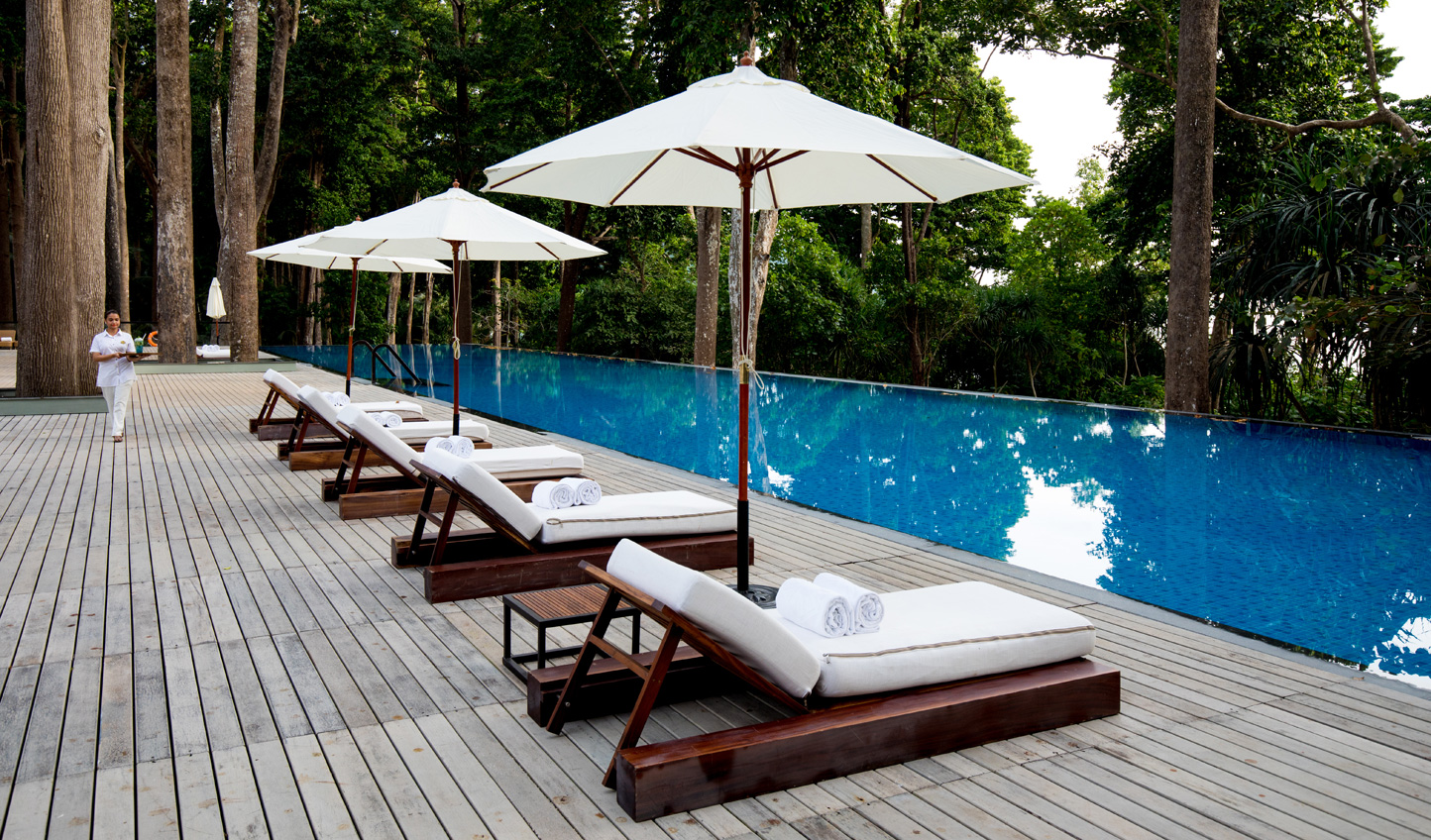 Relax by the pool and feel your stresses slip away