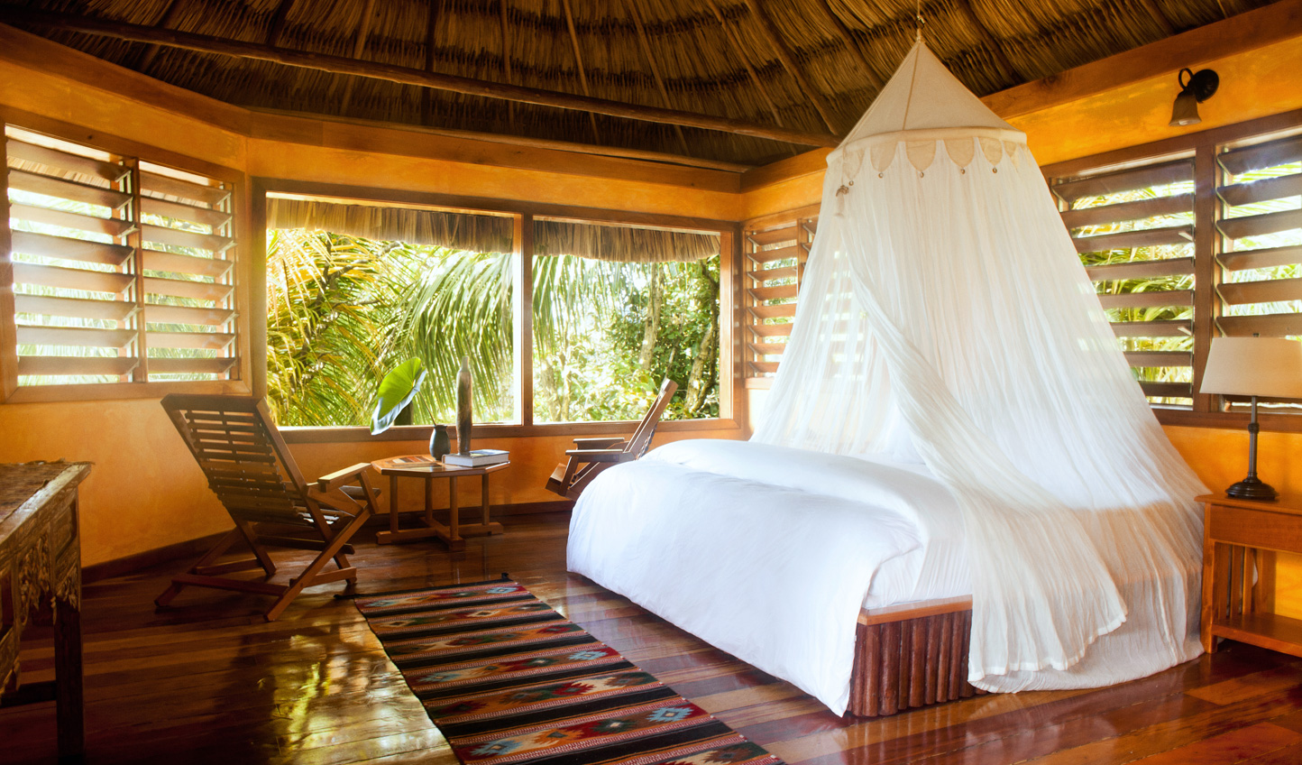 Indigineous materials are topped with delicate linens in your cabana