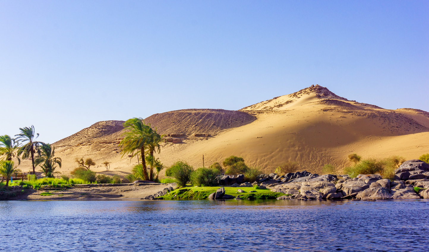 Where rolling dunes fall away into the waters of the Nile