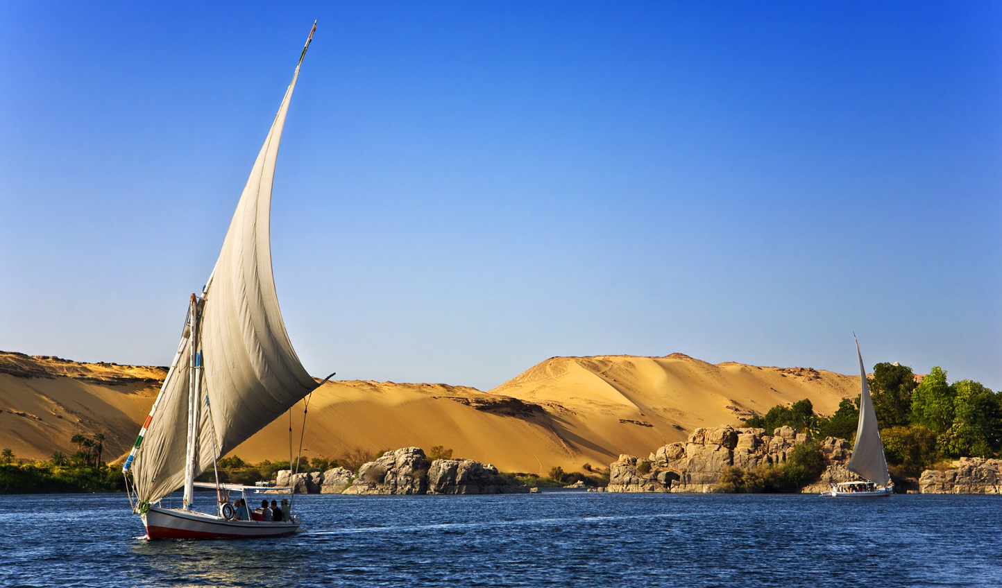 Enjoy a leisurely lunch floating down the Nile on a traditional felucca