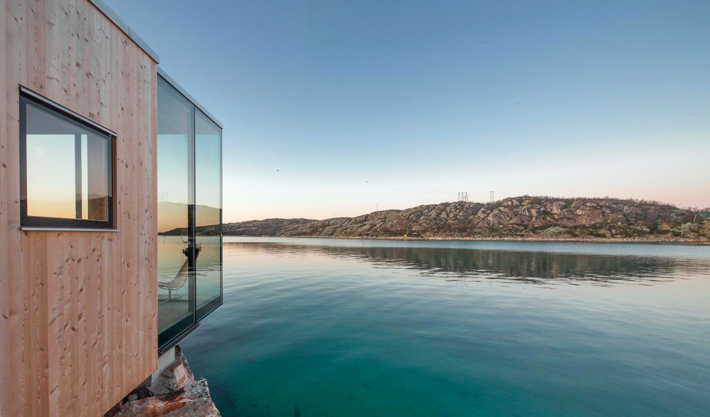 Soak in the views from the stunning design of your glass-fronted sea cabin