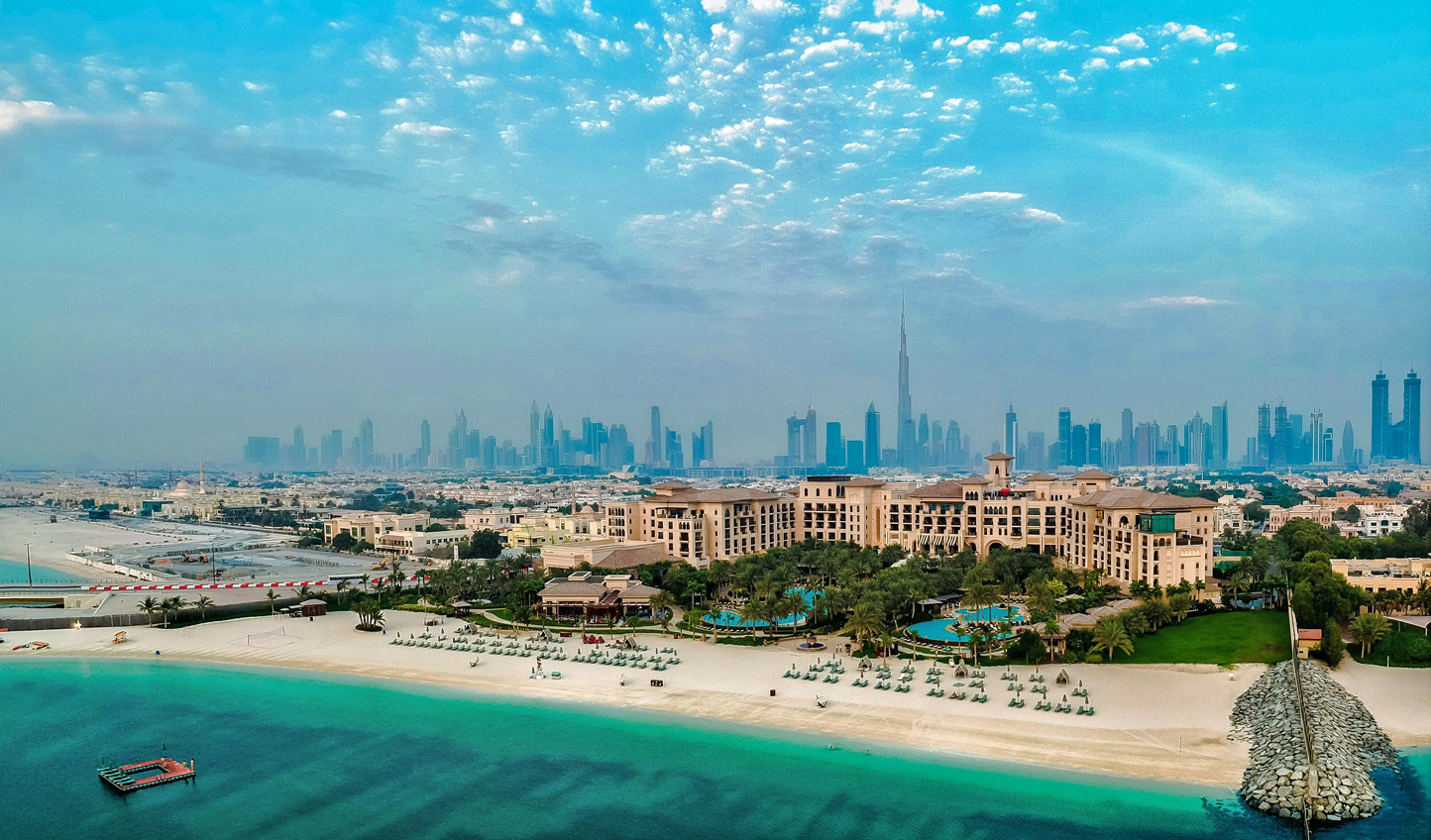 Caught somewhere between the glimmer of the Arabian Gulf and the promise of the city skyline